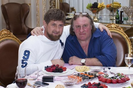 Actor Gerard Depardieu (R) poses for a picture with Chechen President Ramzan Kadyrov during a meeting at the presidential residence as he vi