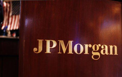 A flag hangs on the wall of the JP Morgan company stall on the floor of the New York Stock Exchange in New York July 15, 2010. REUTERS/Lucas