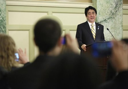 Japan's Prime Minister Shinzo Abe makes remarks at a reception with Japan-US Cultural Exchange Representatives in Washington, February 22, 2