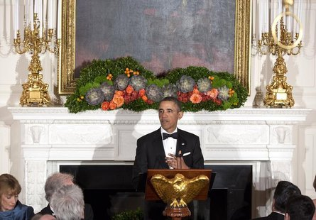 U.S. President Barack Obama makes a toast during the 2013 Governors' Dinner in the State Dining Room of the White House in Washington Februa
