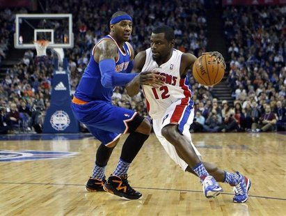 Detroit Pistons point guard Will Bynum (12) drives the ball past New York Knicks small forward Carmelo Anthony (7) during their regulation N