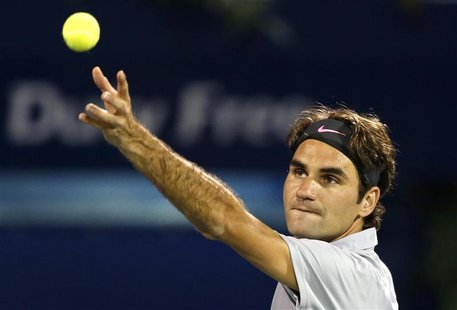 Roger Federer of Switzerland serves to Malek Jaziri of Tunisia during their men's singles match at the ATP Dubai Tennis Championships, Febru