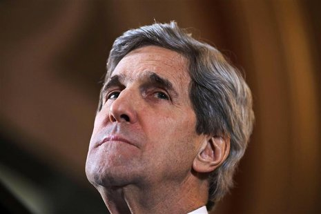 U.S. Secretary of State John Kerry listens to a question during a joint news conference with Britain's Foreign Secretary William Hague at th