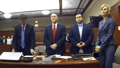 George Zimmerman (2nd R) is pictured with his attorneys Mark O'Mara (L), Don West, and Lorna Truett (R) in Seminole circuit court in Sanford