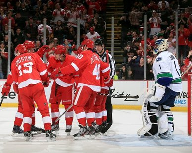 A FREQUENT SIGHT: Detroit Red Wings players celebrate in front of Vancouver goaltender Roberto Luongo (R) after one of their eight goals in an 8-3 triumph over the Canucks on Feb. 24, 2013. (Photo courtesy Detroit Red Wings)