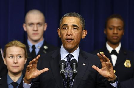 U.S. President Barack Obama speaks against automatic budget cuts scheduled to take effect friday, while in the South Court Auditorium in the Eisenhower Executive Office Building in the White House complex in Washington February 19, 2013. Credit: Reuters/Larry Downing