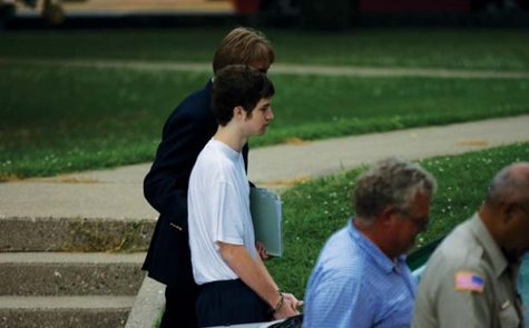 Terry Payton being led to court