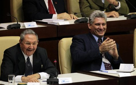 Cuba's President Raul Castro and newly elected first vice president Miguel Diaz Canel, (R), attend the closing session of the National Assem