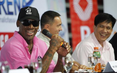 Former NBA Chicago Bulls player Dennis Rodman (L) shares a light moment during a news conference inside a mall of Asia Arena in Manila July