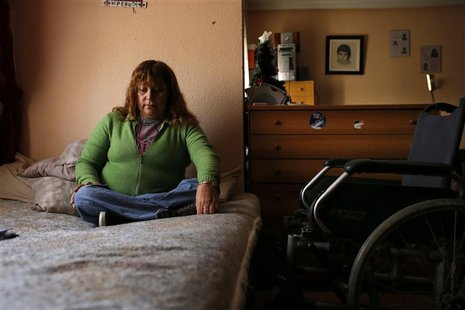 Marcheline Rosero, 45, disabled from the effects of polio as a child in Ecuador, sits on her bed in her flat in Madrid December 17, 2012. RE