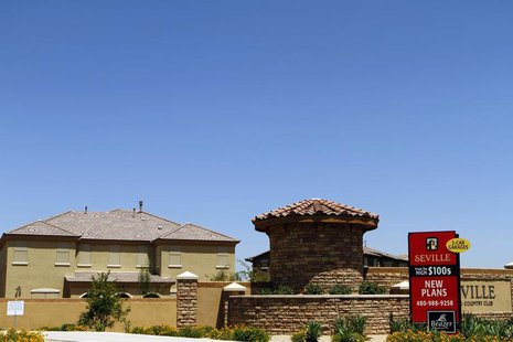 A sign advertising new homes starting at the price of $100,000 is displayed in Chandler Heights, Arizona June 2, 2011. REUTERS/Joshua Lott