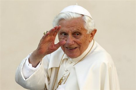 Pope Benedict XVI waves as he arrives to lead the Wednesday general audience in Saint Peter's square, at the Vatican in this October 24, 201