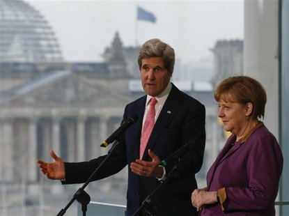 German Chancellor Angela Merkel and U.S. Secretary of State John Kerry speak to media at the Chancellery in Berlin February 26, 2013. REUTER