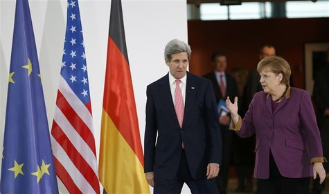 German Chancellor Angela Merkel and U.S. Secretary of State John Kerry arrive to address the media at the Chancellery in Berlin February 26,
