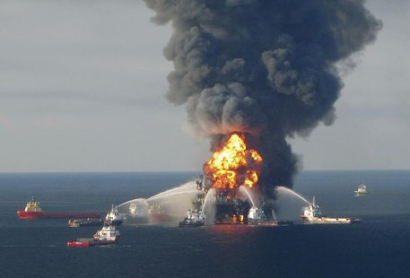 Fire boat response crews battle the blazing remnants of the offshore oil rig Deepwater Horizon, off Louisiana, in this April 21, 2010 file h