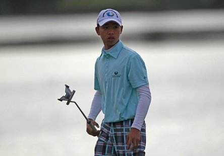Chinese golfer Guan Tianlang, 14 year old, walks on the 11th during the second round of the Australian Open golf tournament in Sydney Decemb