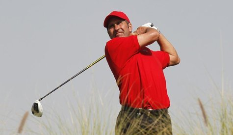 Jose Maria Olazabal of Spain watches the ball during the second round of the Commercial Bank Qatar Masters at the Doha Golf Club January 24,