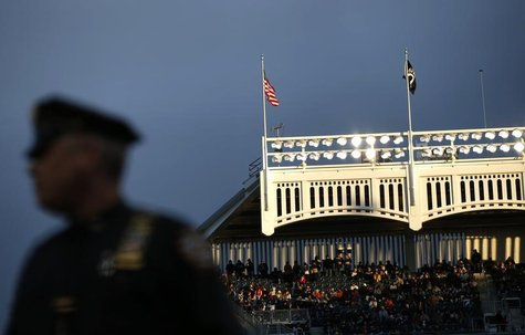 A New York City Police Officer stands guard at Yankee stadium in New York, in this file photo taken October 12, 2012. REUTERS/Mike Segar