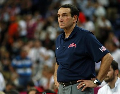 Mike Krzyzewski watches his team against Spain during their men's gold medal basketball match at the North Greenwich Arena in London during