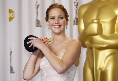 "Jennifer Lawrence, best actress winner for her role in ""Silver Linings Playbook,"" poses with her Oscar backstage at the 85th Academy Awards"