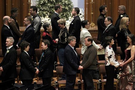 Same sex couples take their vows during a group wedding at the First Baptist Church in Seattle, Washington December 9, 2012. REUTERS/Jordan