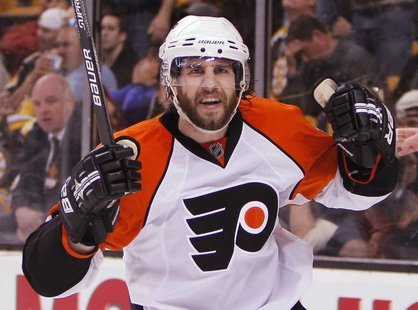 Philadelphia Flyers Simon Gagne celebrates the game-winning goal on the Boston Bruins during the third period in Game 7 of their NHL Eastern