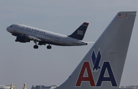 A U.S. Airways jet departs Washington's Reagan National Airport next to an American Airlines jet outside Washington, February 25, 2013. REUT