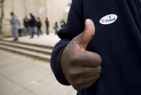 A voter gives a thumb's up after voting at the Martin Luther King Jr. Elementary School in the Anacostia neighborhood of Washington, in this