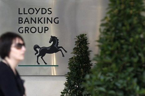 A pedestrian passes the head office of Lloyds Banking Group in central London April 11, 2011. REUTERS/Stefan Wermuth