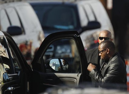 Whitney Houston's ex-husband, Bobby Brown leaves before the start of the funeral service for the pop singer at the New Hope Baptist Church i