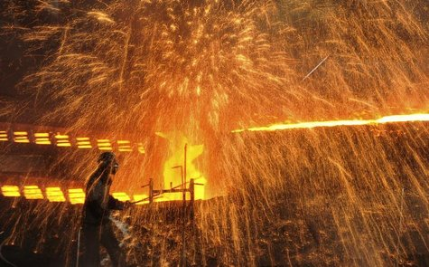 A labourer works at a steel factory in Dalian, Liaoning province December 4, 2012. REUTERS/China Daily