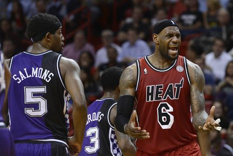 Sacramento Kings' John Salmons (L) watches Miami Heat's LeBron James (R) react to a call by an official during the first half of their NBA b