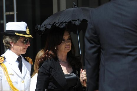 Argentina's President Cristina Fernandez De Kirchner (R) is seen as she arrives to speaks with the media at the summit of the Community of L