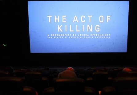 "The opening of ""The Act of Killing"", a documentary made by Texan-born director Joshua Oppenheimer, is pictured during an underground screeni"