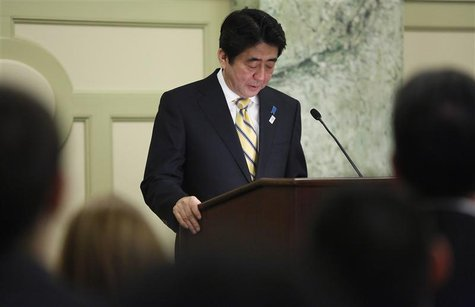 Japan's Prime Minister Shinzo Abe pauses during remarks at a reception with Japan-US Cultural Exchange Representatives in Washington, Februa