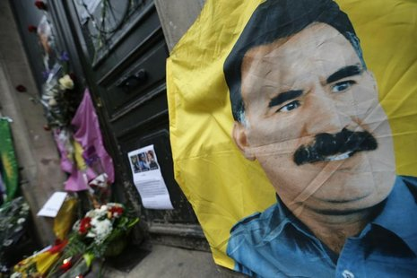 A flag with the portrait of jailed Kurdistan Workers Party (PKK) leader Abdullah Ocalan is seen in front of the entrance of the Information