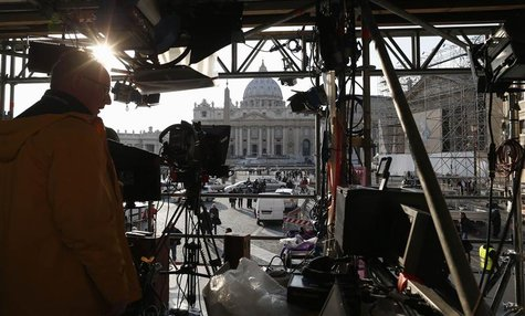 A technician works on structure set up for TV media in front of St. Peter's Square in Rome February 26, 2013. REUTERS/Alessandro Bianchi