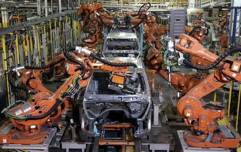 Auto assembly line robots weld on the frame of 2009 Dodge Ram pick-up trucks at the Warren Truck Assembly Plant in Warren, Michigan Septembe