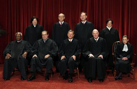The justices of the U.S. Supreme Court gather for a group portrait in the East Conference Room at the Supreme Court Building in Washington,