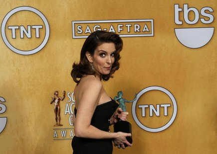 Actress Tina Fey holds her award for outstanding performance by a female actor in a comedy series backstage at the 19th annual Screen Actors