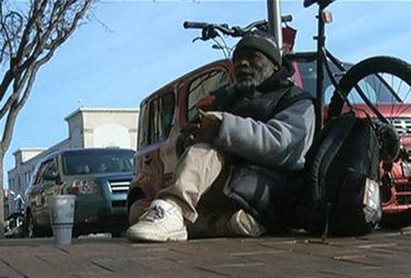 Homeless man Billy Ray Harris collects change in this undated image taken from video courtesy of KCTV5, in Kansas City Missouri. REUTERS/KCT