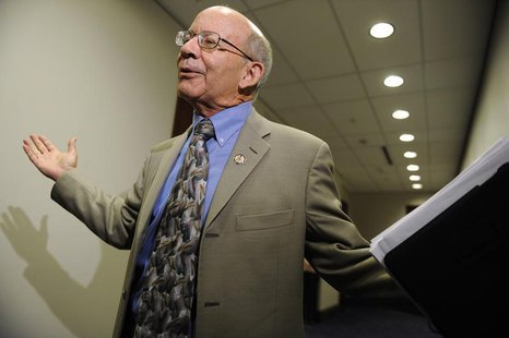 U.S. Representative Peter DeFazio (D-OR) throws up his hands as he talks to reporters after a Democratic caucus meeting about debt relief le