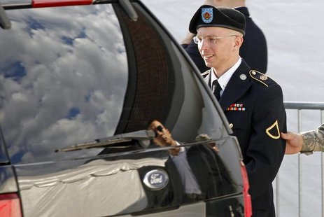 Army Private First Class Bradley Manning is escorted in handcuffs as he leaves the courthouse in Fort Meade, Maryland June 6, 2012. REUTERS/