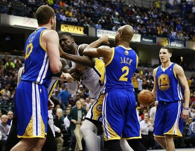 Indiana Pacers center Roy Hibbert (2nd L) shoves Golden State Warriors forward David Lee (L) while Warriors guards Jarrett Jack (2) and Klay