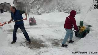 Residents in Manitowoc clear snow from their driveway, Wednesday, February 27, 2013. (courtesy of FOX 11).