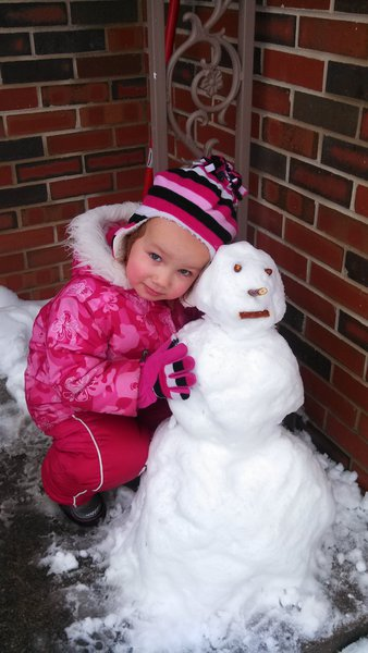 Her first snow man of the year.