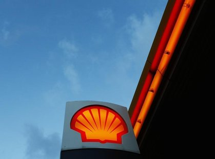 A Shell logo is seen at a petrol station in London January 31, 2013. REUTERS/Luke MacGregor