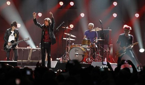"Ron Wood (L), Mick Jagger (2nd L), Charlie Watts and Keith Richards (R) of the Rolling Stones perform during the ""12-12-12"" benefit concert"