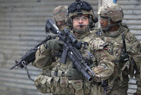 U.S. troops with the International Security Assistance Force (ISAF) keep watch at the site of a suicide attack in Kabul, February 27, 2013.