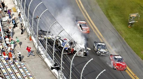 NASCAR driver Kyle Larson (32) and his Chevrolet end up in the fence during the final lap crash during the during the NASCAR Nationwide Seri